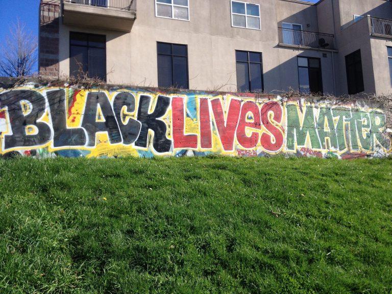 Black lives matter graffiti on wall